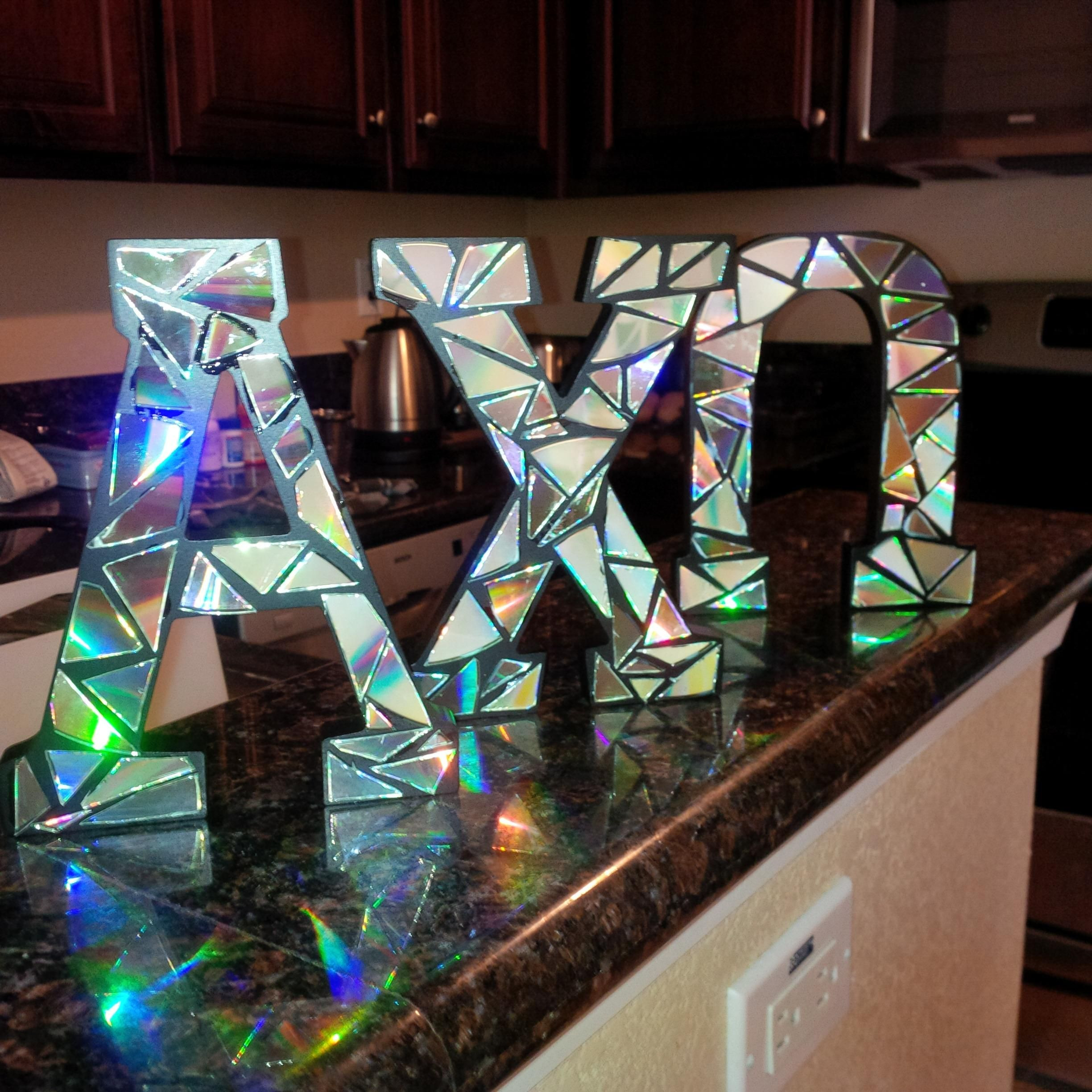 Delta Handwerk  Wooden letters covered in cut up CDs a new take for our