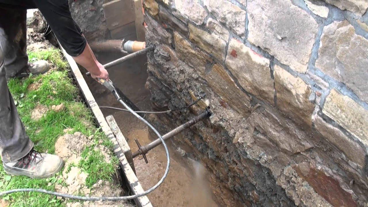 Drainage Haus  Außenwandsanierung Drainage mit Pumpenschacht Einbau