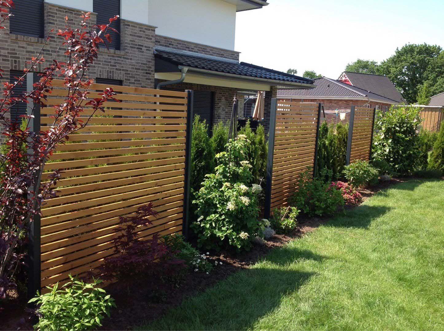 Sichtschutz Im Garten  Design Sichtschutz halbdurchlässig aus Metall Holz