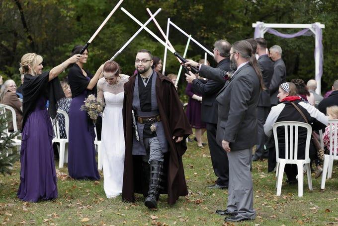 Star Wars Hochzeit  Star Wars themed wedding in Wisconsin includes lightsaber